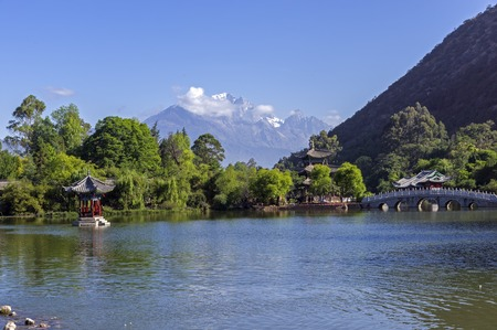 Lijiang old town scene-Black Dragon Pool Park. . In there, you can see Jade Dragon Snow Mountain. Stock Photo