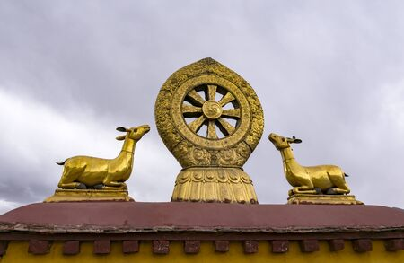 Rooftop statues of two golden deer and Dharma wheel in Jokhang temple - Lhasa, Tibet