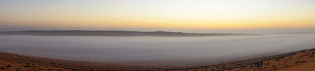 Panoramic of Sunrise in Wahiba Sands desert in Oman with mist
