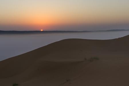 Sunrise with mist in Wahiba Sands desert in Oman