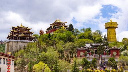 Giant tibetan prayer wheel and Zhongdian temple in Shangri-la - Yunnan province, China. World biggest prayer wheel.