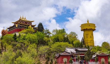 tibetian: Giant tibetan prayer wheel and Zhongdian temple in Shangri-la - Yunnan province, China. World biggest prayer wheel.