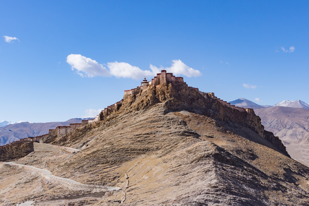 Gyantse Dzong fortress. It is one of the best preserved dzongs in Tibet, perched high above the town of Gyantse on a huge spur of grey brown rock - Tibet