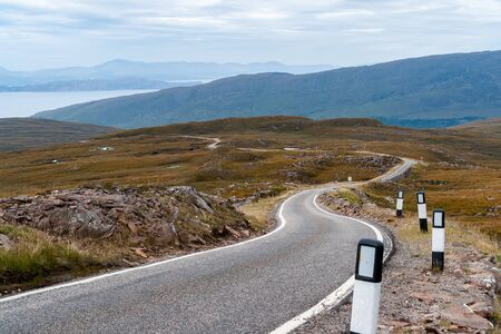 one lane road sign: A narrow single-track road in the remote Western Highlands - Scotland, UK