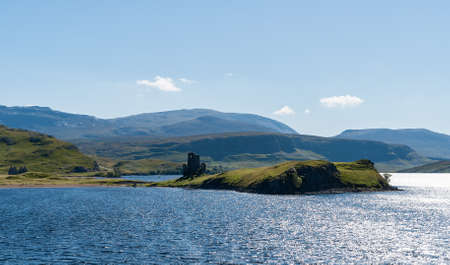 downstream: Typical Scottish Highlands lake landscape with a ruined castle and mountains - Highlands, Scotland, UK