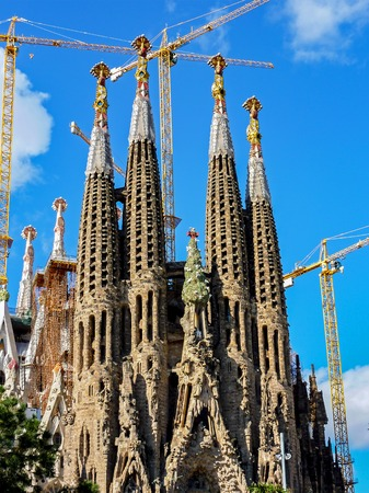 Construction of Sagrada Familia in Barcelona - Spain. The Sagrada Fam is a large unfinished Roman Catholic church in Barcelona, designed by Antoni Gaudi.