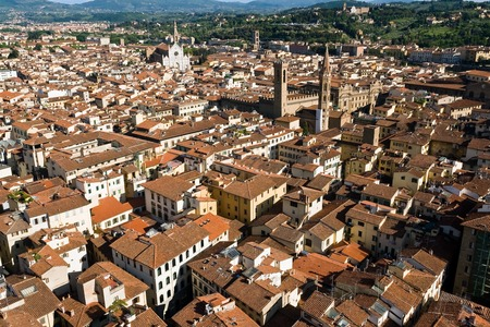 An aerial panoramic view of Florence from the top of the Campanile - Florence, Tuscany, Italy. You can see Church of Santa Croce and Bargello museum surrounded by the typical red roofs of the town