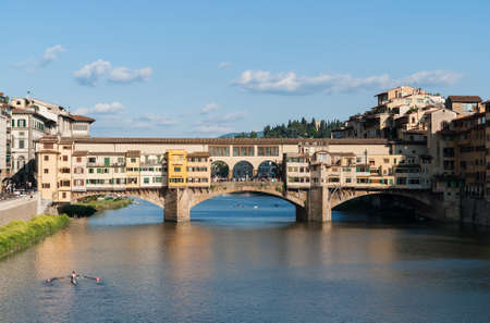 The Ponte Vecchio old bridge over river Arno - Florence, Tuscany, Italy. Built very close to the Roman crossing, the Ponte Vecchio, was the only bridge across the Arno in Florence until 1218