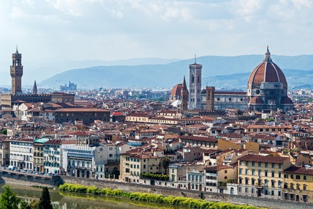 Panoramic view of Florence major monuments - Florence, Tuscany, Italy. You can see Duomo Cathedral, Campanile of Giotto and Palazzo Vecchio surrounded by the typical red roofs of the town Stock Photo