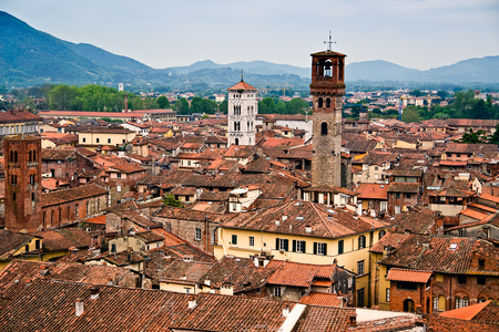 Aerial view of the Italian medieval city of Lucca, seen from the top of the Torre Guinigi - Tuscany, Italy