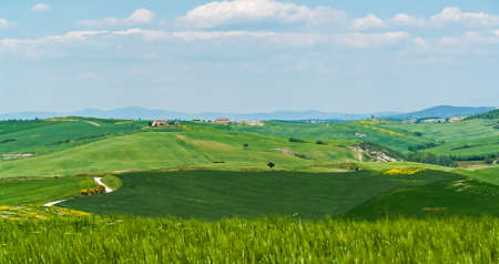 Typical Tuscany Landscape with Houses and Hills - Tuscany, Italy Stock Photo