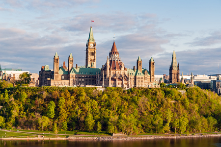 Sunset on Parliament Hill, in Ottawa - Ontario, Canada. Its Gothic revival suite of buildings is the home of the Parliament of Canada. Stock Photo