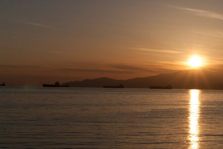 Sunset over Vancouver Bay and tankers - British Columbia, Canada