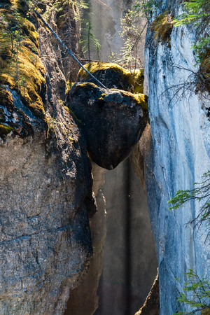 Two heart shaped Chockstones in Maligne Canyon - Canadian Rockies, Jasper National Park, Alberta, Canada. Chockstone is a stone wedged in a crack.