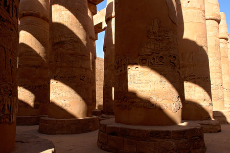Columns covered with hieroglyphics in majestic hypostyle hall at Karnak Temple - Luxor, Egypt Stock Photo