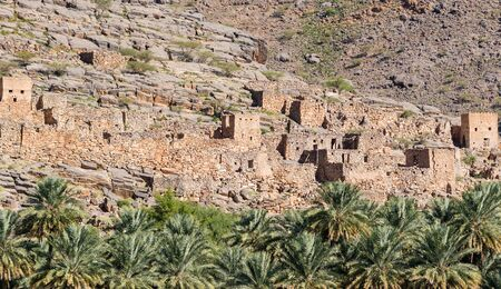 Abandoned village ruins of Riwaygh as-Safil in Necrosis valley - Sultanate of Oman Stock Photo