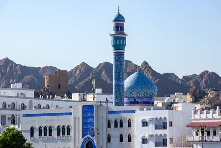 Blue Dome and Minaret of Mutrah Mosque with mountain in Background - Muscat, Oman