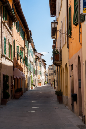 Beautiful narrow street with old facades in a tuscany village - Italy Editorial
