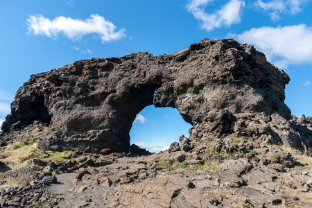 Lava window at Dimmuborgir, Myvatn area - Iceland. The Dimmuborgir area is composed of various volcanic caves and rock formations, reminiscent of an ancient collapsed citadel. Stock Photo