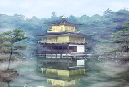 Mist on the Golden Pavilion at Kinkakuji Temple - Kyoto, Japan. Kinkakuji is a Zen temple in northern Kyoto whose top two floors are completely covered in gold leaf.