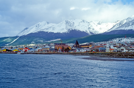 View on the Center of Ushuaia - Tierra del Fuego, Argentina. Ushuaia is the capital of Tierra del Fuego. It is commonly regarded as the southernmost city in the world. Stock Photo