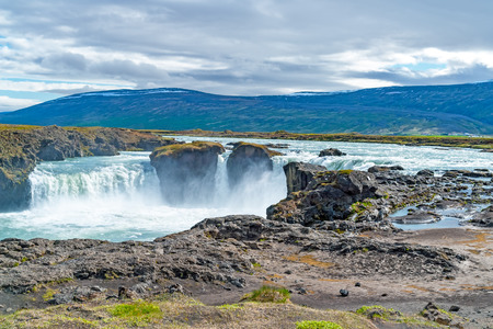 Godafoss waterfall, or waterfall of the gods - Northern Iceland. The water of the river Skjalfandafljot falls from a height of 12 meters over a width of 30 meters. Stock Photo
