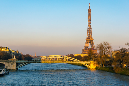 Sunset on Eiffel tower and Pont Rouelle - Paris, France. The Pont Rouelle is only a railway bridge and was constructed for the 1900 World Fair. Stock Photo