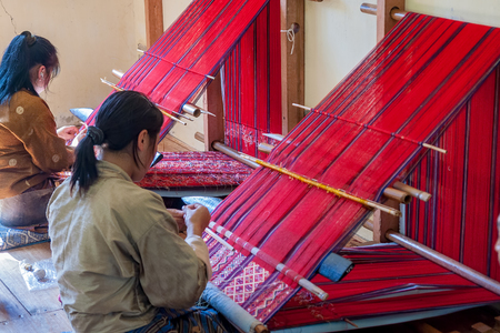 Bhutanese woman weaving - Eastern Bhutan. Women of eastern Bhutan are skilled at weaving and some of the most highly prized textiles are woven by them.