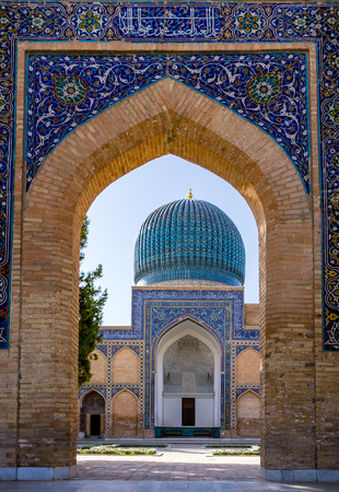 View of Gur-e Amir mausoleum of Timur through the entrance - Samarkand, Uzbekistan. Its architectural complex contains the tombs of Tamerlane, his sons and grandsons.