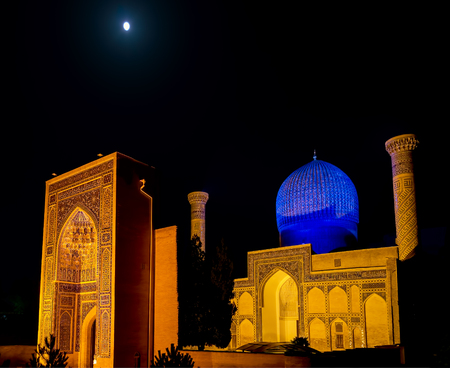 Full moon over Gur-e Amir mausoleum of Timur at night - Samarkand, Uzbekistan. Its architectural complex contains the tombs of Tamerlane, his sons and grandsons.