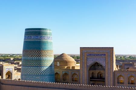 Unfinished turquoise-tiled Kalta Minor Minaret and Madrassah of Muhammad Amin-khan at Ichan Qala - Khiva, Uzbekistan Stock Photo