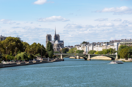 Notre Dame de Paris view from Pont dAusterlitz with seine river in foreground- Paris, France