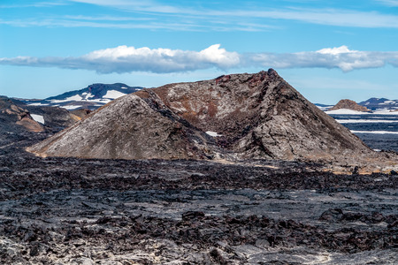Krafla Lava Fields - Iceland. Itis located in Leirhnjukur, a few hundred meters down from Viti Crater, are a wide area of sulfur vapors and still hot volcanic lavas. Stock Photo