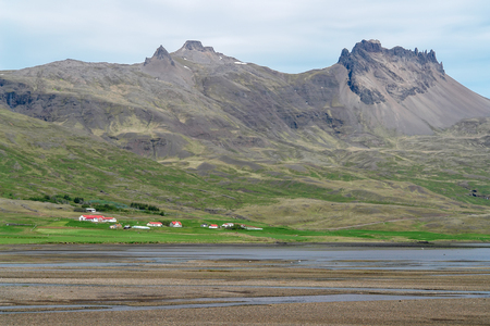 Typical Iceland landscape with farms - South Iceland