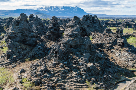 Dimmuborgir lava field, Myvatn area - Iceland. The Dimmuborgir area is composed of various volcanic caves and rock formations, reminiscent of an ancient collapsed citadel.