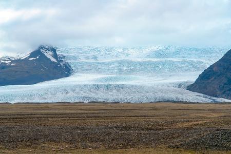 Glacier in Vatnajokull National Park on a cloudy day - Iceland. Vatnajokull glacier is the largest glacier in Europe. Stock Photo