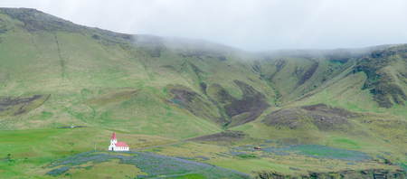 Isolated small wooden church with red roof in Vik i Myrdal- South Iceland Stock Photo