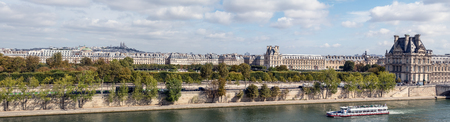 Panoramic view of Paris from Musee dOrsay rooftop with the Seine, Tuileries Garden, Palais royal, Opera Garnier, Sacre-Coeur and Montmartre hill