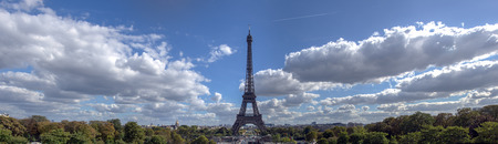 Panoramic view of Eiffel tower and surrounding with cloudy sky. Taken from Trocadero in September - Paris, France. Stock Photo