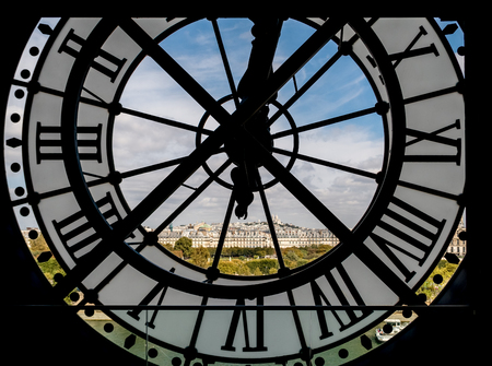 Paris cityscape through the giant clock at the Musee dOrsay with view on the Seine river, Tuileries Garden, Palais royal, Sacre-Coeur and Montmartre hill - Paris, France Editorial