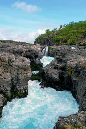 Barnafoss waterfall - Western Iceland. Water flows near Barnafoss waterfall, called also Waterfall of the children