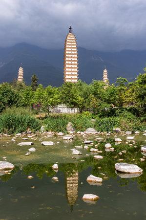 Dali three white pagodas and Cangshan Mountain - Yunnan, China.