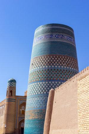 Unfinished turquoise-tiled Kalta Minor Minaret at Ichan Qala - Khiva, Uzbekistan