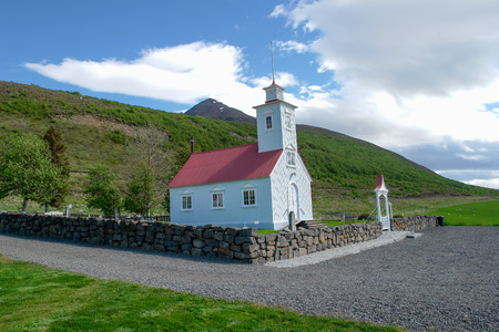 Typical small wooden church with red roof - North Iceland Editorial