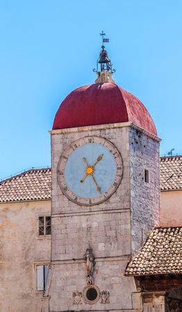 The historic clock tower of St Sebastian church in the center of the city Trogir - Croatia