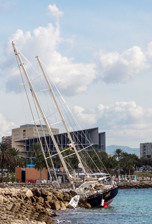 Yacht washed up on shore in Palma de Mallorca after heavy seas in October 2018 - Balearic Islands, Spain Editorial