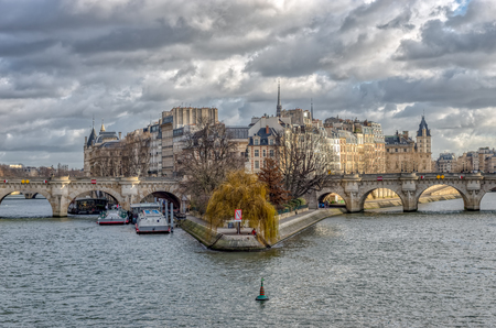 Ile de la Cite and Pont Neuf on a cloudy day in winter - Paris, France