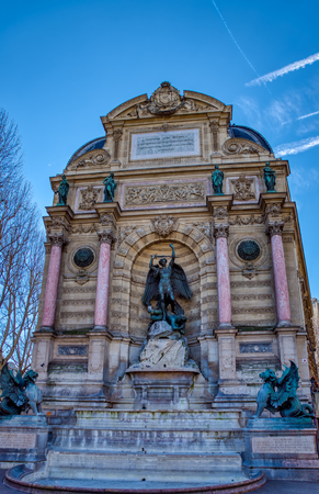 Fountain Saint-Michel at Place Saint-Michel in Paris, France. It was constructed in 1858-1860 during French Second Empire by architect Gabriel Davioud.