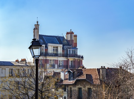 Montmartre Cityscape in winter with a vintage street lamp in foreground - Paris, France