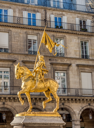 Paris, France - March 11 2019: Statue of Joan of Arc (Jeanne d'Arc in french) on Place des Pyramides in Paris. This gilded bronze equestrian sculpture was created in 1874 by Emmanuel Fremiet.